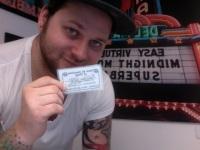 Matthew and his membership card